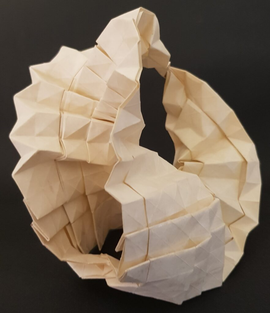 Enterprise Model was made from one piece <br>of paper with combination of classic <br>tessellation, pleat and corrugation techniques
