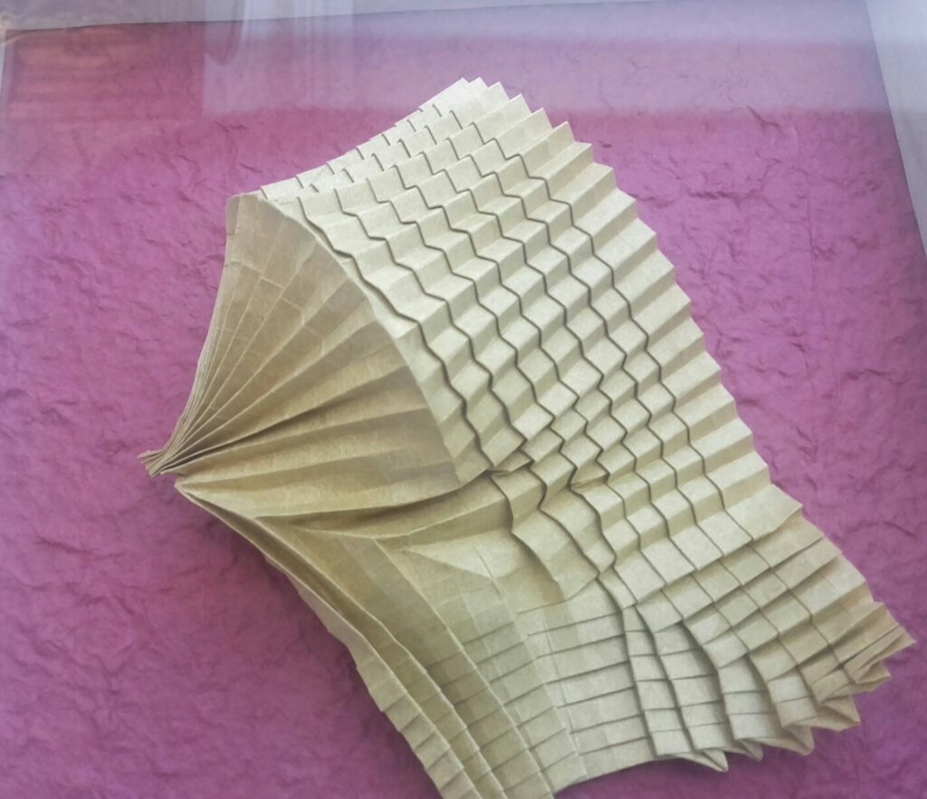 Wave Model was made from <br>one piece of paper with combination <br>of classic tessellation, pleat <br>and corrugation techniques.