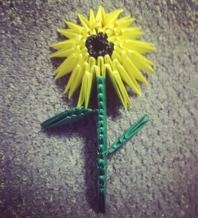 Sunflower (Traditional technique) - Golden Venture technique (3D origami), 75 sheets of 3 by 6 inch green, yellow and black kami. Folder: Lisa B. Corfman. Folded in 2017-2018.