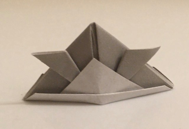 Kabuto: Gray-White 2 inch square kami. Folder: Lisa B. Corfman. Folded: August 9, 2020.