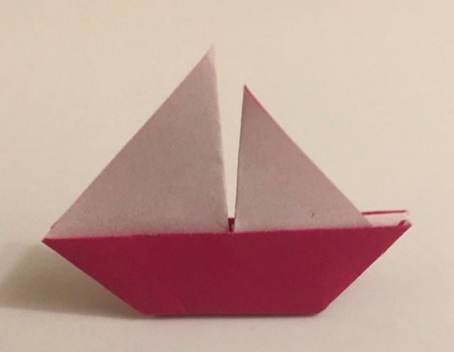 Sailboat: Magenta-White 2 inch square kami. Folder: Lisa B. Corfman. Folded August 9, 2020.