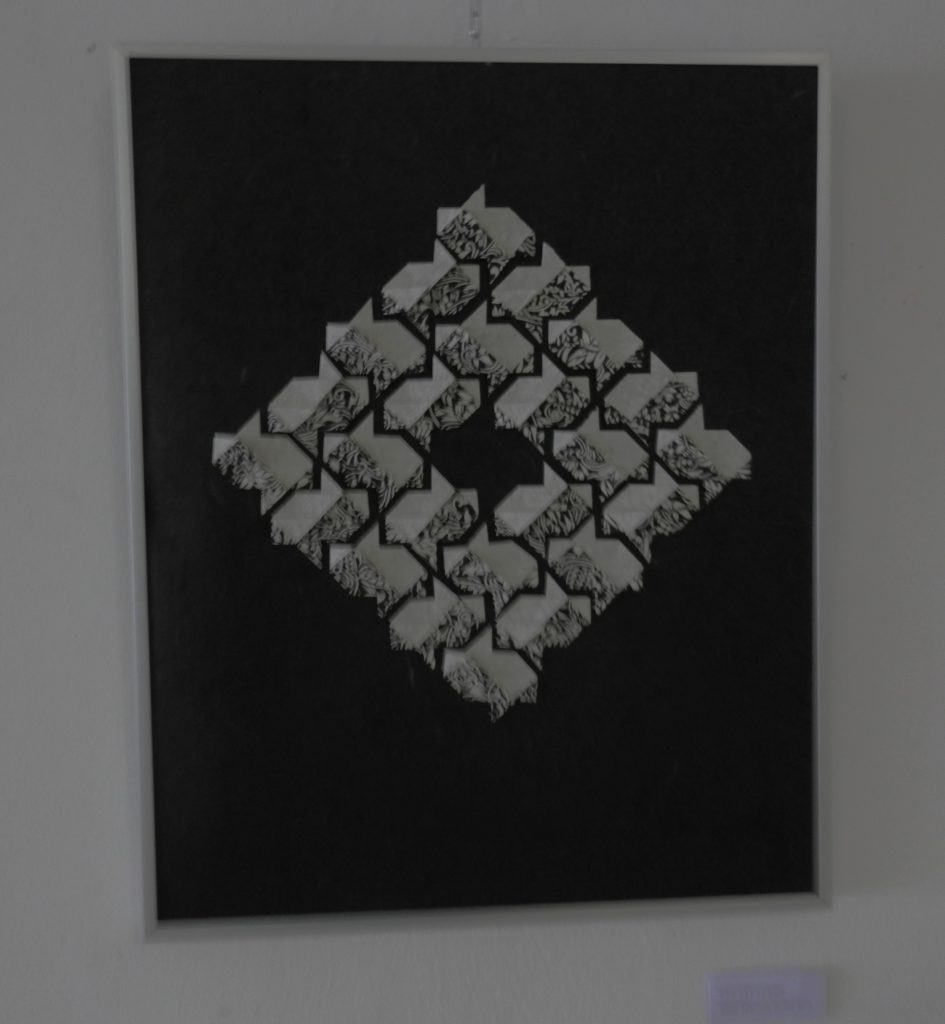 DOUBLE FISH TILES   2015 Each tile is an origami folded from a square of Japanese printed washi. Inspired by iso-area folding and M.C. Escher. If arranged between two glass sheets, the tiles would give the same effect at the front and at the back.