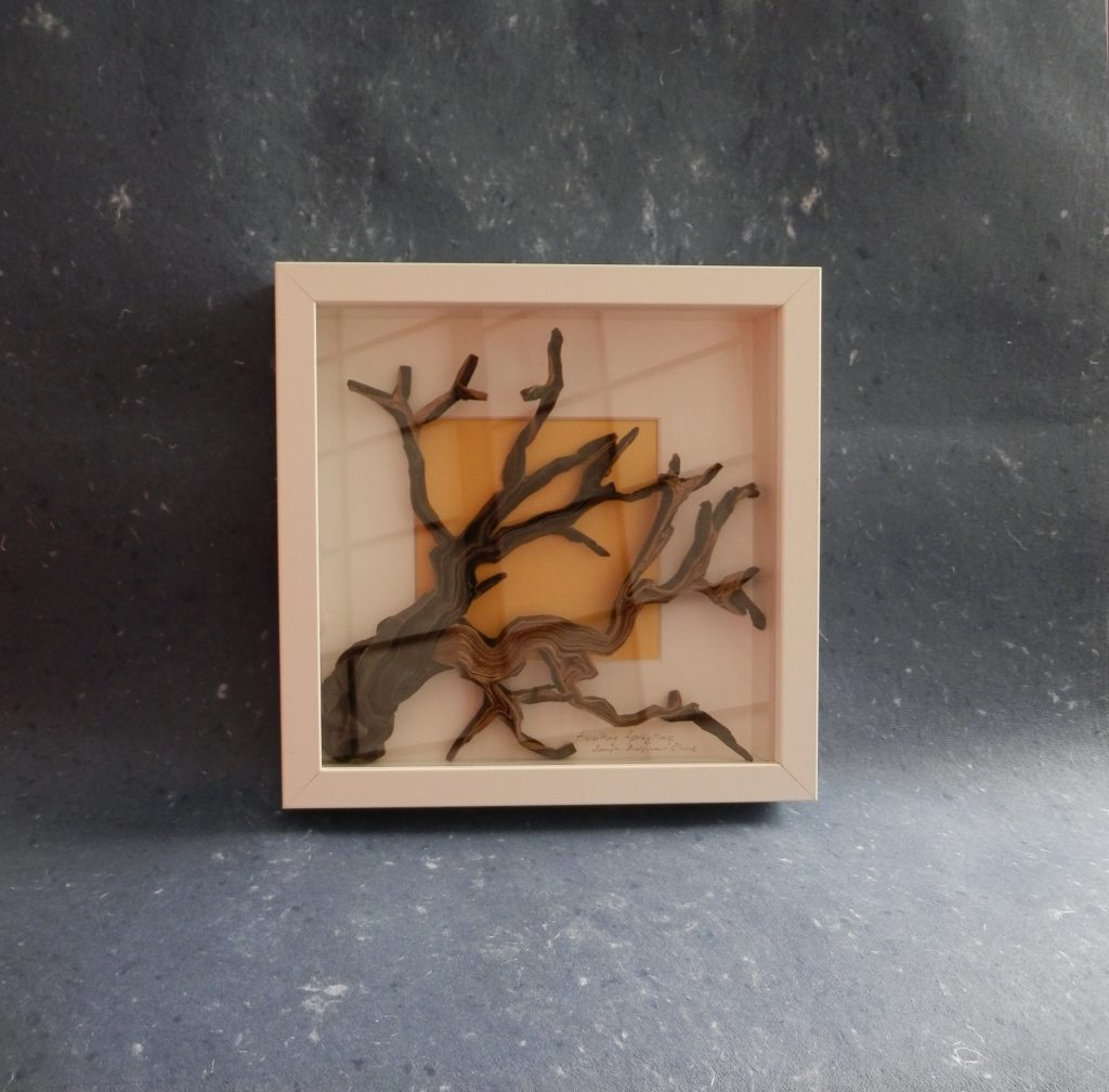 AWAITING SPRINGTIME Wet folded from duo kraft paper 70 x 70 cm. Framed size 25 x 25 x 4 cm  Donated to Mujeres de Papel exhibition in EMOZ, Zaragoza, Spain 2016.