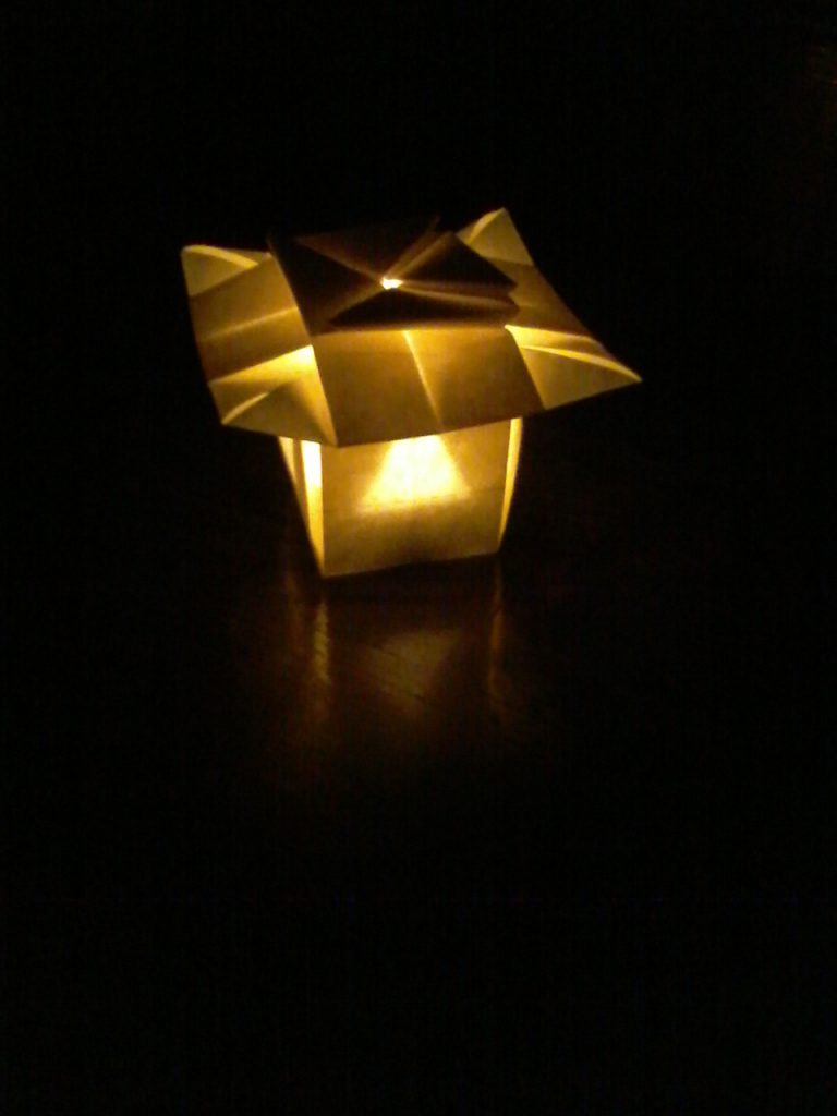 LANTERN  created 2013 folded 2020 (Elephant Hide paper, LED tealight;  7.5 x 7.5 x 5 cm) Through this lantern, I felt the Japanese concept of 'hare' and 'ke' coming closer to me. Without the light, in the daytime, it looked very 'ke'. As a dim night light, it sung 'hare' to me.